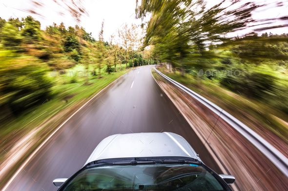 motion blurred picture of driving car by mdurinik. car driving fast, POV