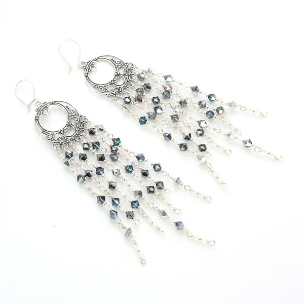 Star-filled night sky. Stunning colours of Swarovski crystals, sparkling with every move. Long, silver, orient-inspired earrings.