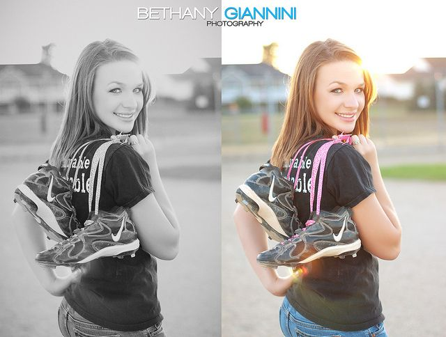 Senior portrait with cleats flung over the shoulder