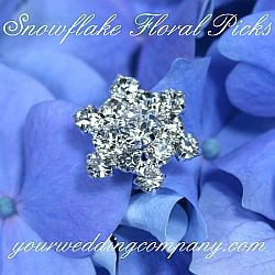 These winter-themed, snowflake picks create sparkling accents in wedding bouquets and reception centerpieces. www.yourweddingcompany.com