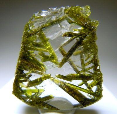"planetvalium: "" Quartz with green Epidote crystals inside. """