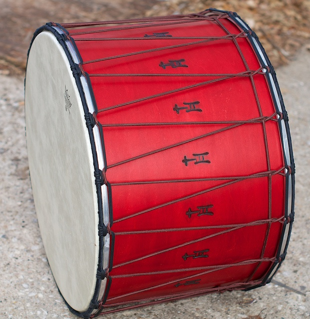 Winter Storm Tupan. This beautiful red Tupan made its debut at the 2013 Winter Storm Drum & Pipe Event in KC. Includes CAD CM217 internal mic and 18-knot rope-tensioned heads. 15×22; plied maple; semi-gloss wax. To see more pix, and search our entire TreeHouse archive for your favorite specs, visit our photo gallery: http://www.flickr.com/photos/treehousedrums/collections/