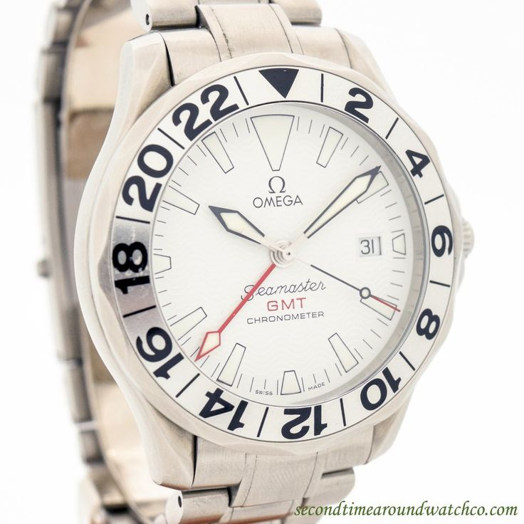 2000's Omega Seamaster GMT Chronometer Ref. 168.1620 Stainless Steel watch with Original White Dial with White Luminous Markers and Original Omega Stainless Steel Bracelet. Triple Signed. Case Excelle