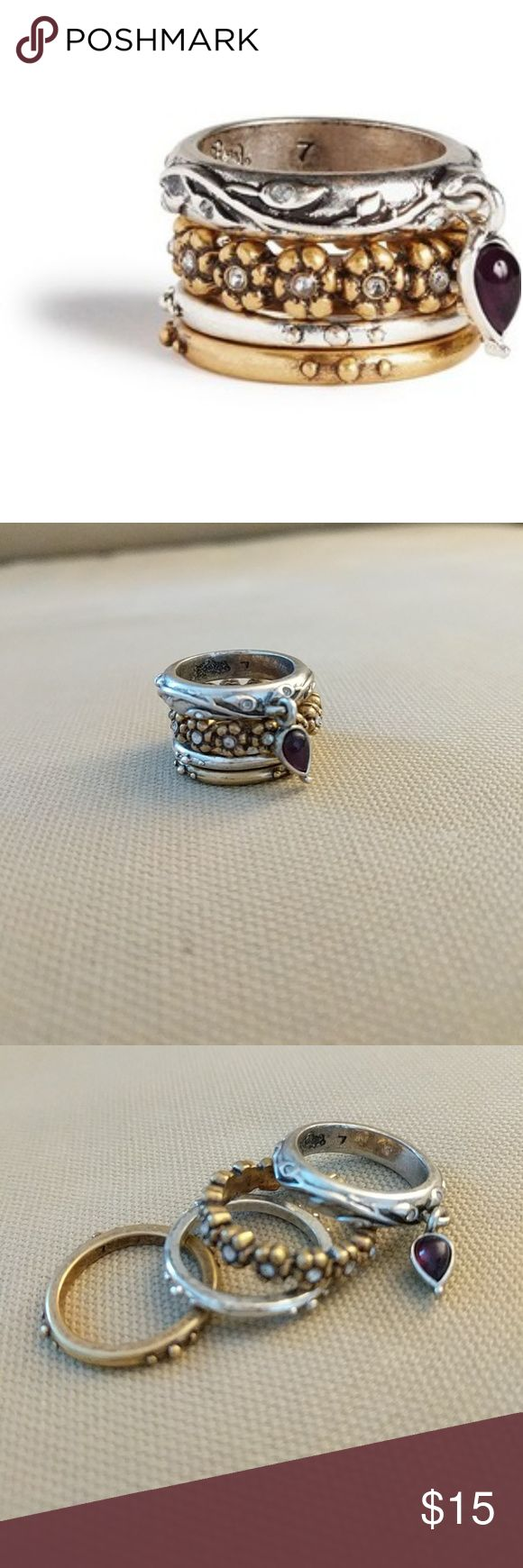 Lucky Brand Two Tone Stackable Ring Gold and silver tone, stackable Lucky Brand ring with floral design and garnet charm. Can be worn separately or together. Size 7, used. Lucky Brand Jewelry Rings