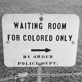 """This image illustrates the government being against the African Americans by the way they are treated. It's showing that the """"colored"""" people need to wait, and assuming that the """"whites"""" don't need to wait. It also states that it's ordered by the police dept. So not only is the public against them, the policemen and government is also discriminating them too.(Denisse)"""