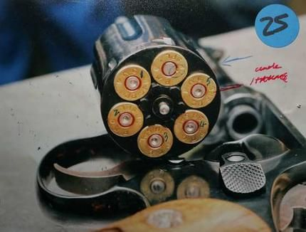 A photo that became a key part of the defence of Mick Gatto in court shows the gun which was fired in a scuffle which ended in the death of Veniamin. The numbers mark the order the bullets were fired, the un-numbered bullet was a missfire. Photo: Craig Sillitoe