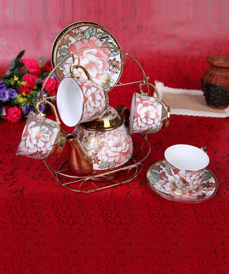 Discover whole new levels of elegance and class at fashionandyou.com as it brings you a very special collection of crockery. Each pick from this assortment is a succinct testament to the taste for refined things in life and will elevate everyday experiences into great memories.CATEGORY: Crockery Set Contains: - 4 Cups - 4 Saucers - 1 Kettle - 1 BracketCOLOUR: White and MultiMATERIAL: High Quality PorcelainSIZE: - Kettle: 500ml - Cups: 100ml - Stand: 8 inches (Height) - Saucer: 4 inches ...