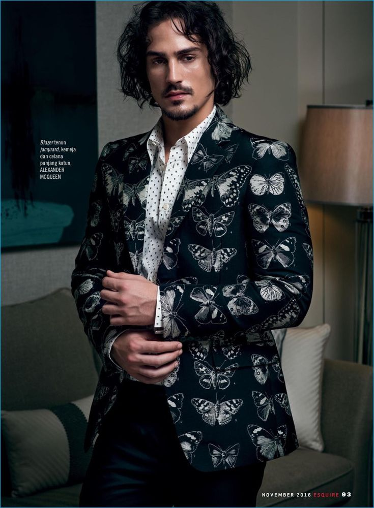 Playing a dandy, Gustavo Krier dons a butterfly print jacket with smart separates by Alexander McQueen.