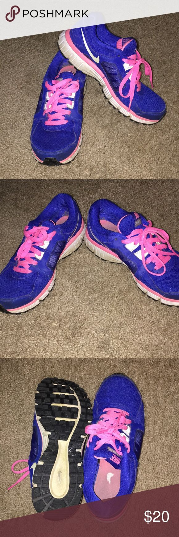 Nike dual fusion running shoes Women's Nike dual fusion running shoes. Blue with pink accents and laces. EUC! Nike Shoes Athletic Shoes