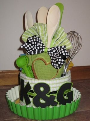 Bridal Shower kitchen towel cake. I like the idea of the tart pan at the bottom to carry it on.
