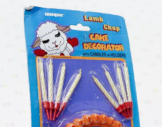 A Cake Decorator Set featuring Shari Lewiss Lamb Chop! The set is sealed in the package, and contains 1 cake centrepiece, and 8 wax candles in plastic holders. Made in 1983 by Unique Ind.  You can thank us later for this throwback ;) https://www.youtube.com/watch?v=1_47KVJV8DU   *****