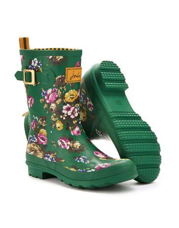 Joules Womens Mid Rain Boot, Green Floral.                     A new shorter style Rain Boot splashed with heritage-inspired prints. For a jaunt outdoors when puddles are present, these are a great way to keep your feet covered.