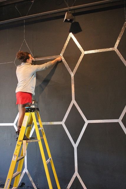 Use foil tape (Home Depot) to make a wall design. Haute DIY Inspiration