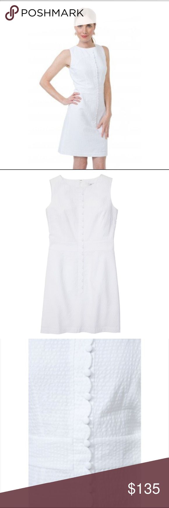 Southern Proper White Dress Southern Proper White Seersucker Scallop Dress.  NWT.  Adorable dress for Spring and Summer.  Where this to an all white party, brunch, country club or boating day.   Match this dress with a gorgeous pair of Tory Burch Sandals.  Take a look at my closet for size and color. Southern Proper Dresses Midi