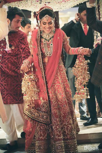 Bridal Lehenga - Bride in a Red Lehenga with Gold Full Embroidery   WedMeGood #wedmegood #indianbride #indianwedding #red #lehenga #bridal #kaleere