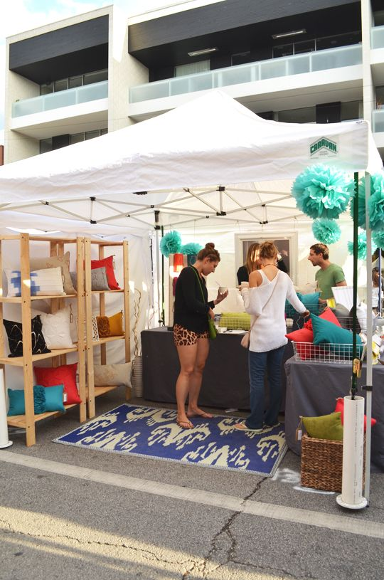 craft fair setup open shelves, wire baskets