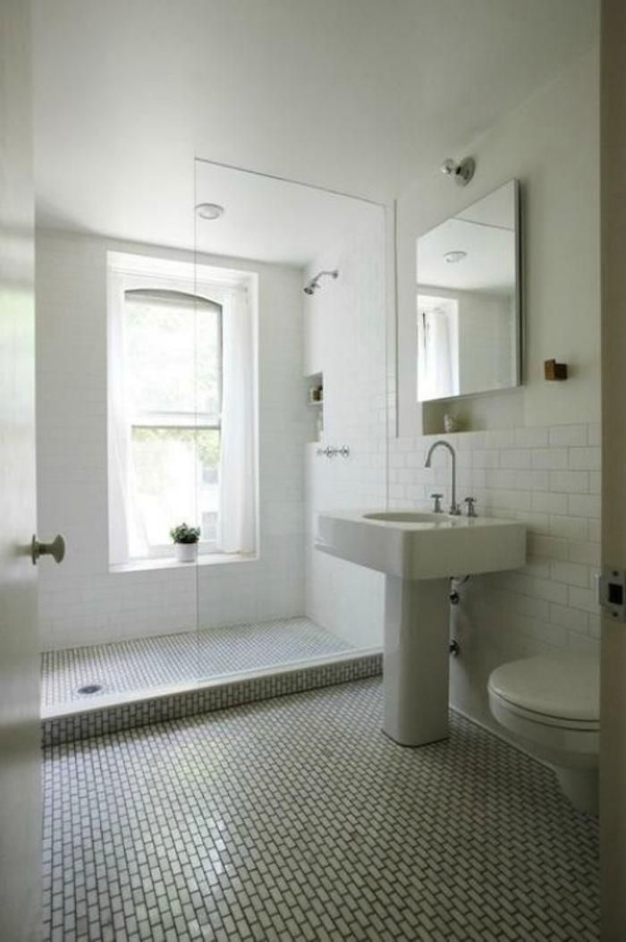 white tile in shower only with small contrast tile on floors
