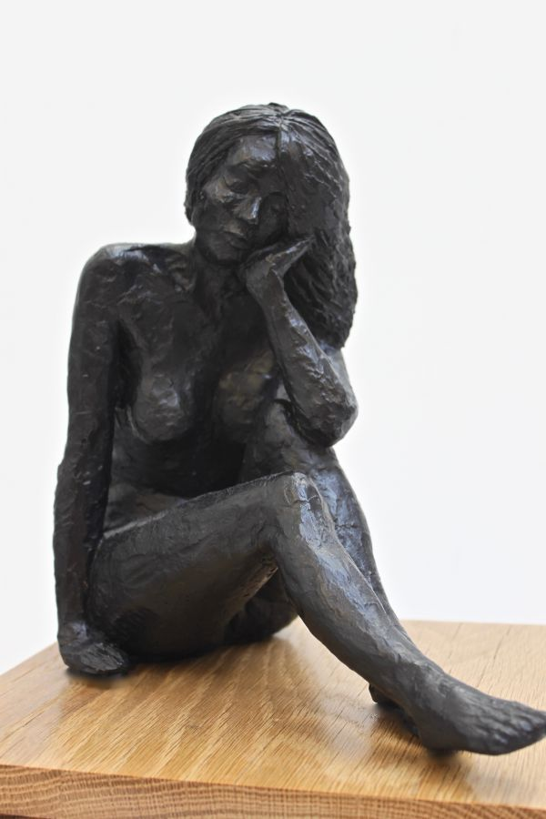 Painted polished plaster on oak #sculpture by #sculptor Eva Humphrey-Lahti titled: 'Black Sitting nude (Naked Resting Thinking statue)'. #EvaHumphreyLahti