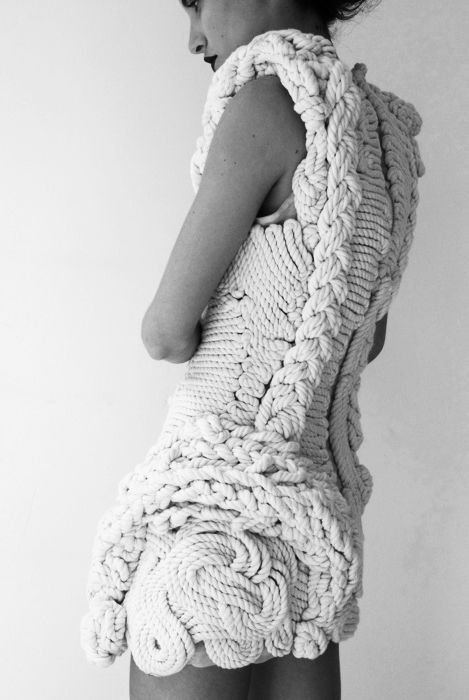 Fashion as Art - intricately structured dress with intertwining rope design; sculptural fashion