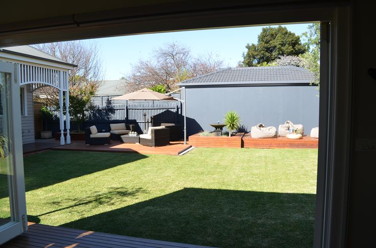 Traditional house renovation.  Backyard.  Verandah. Lawn. Decking. Outdoor living. Lisa Banducci Design.