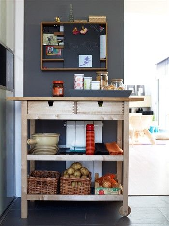 a kitchen trolley with wicker baskets on shelves tray on top and wall shelving above for the. Black Bedroom Furniture Sets. Home Design Ideas
