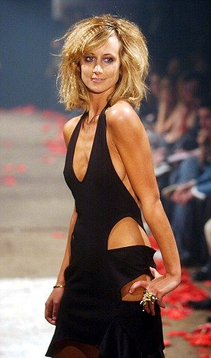 The star modelling for designer Scott Henshall during his autumn/winter 2003 show at London Fashion Week