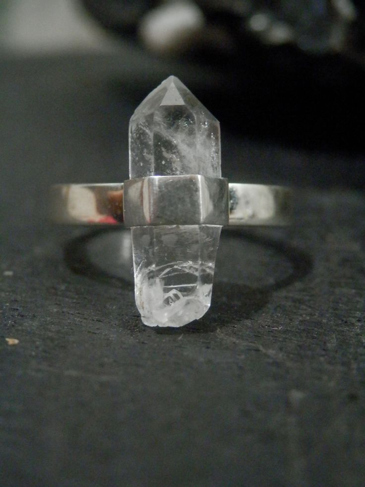 This ring is a natural Clear Quartz point that is set in a sterling silver on a plain silver band. Each crystal is naturally shaped making every piece of Immortal Earth jewellery one of a kind. -Natural Clear Quartz crystal point-925 Sterling Silver-Size M 1/2-Crystal is approx 17mm in lengthClear quartz is the most powerful healing and energy amplifier on the planet. It absorbs, stores, releases and regulates energy and is amazing for unblocking it. It works with yo...