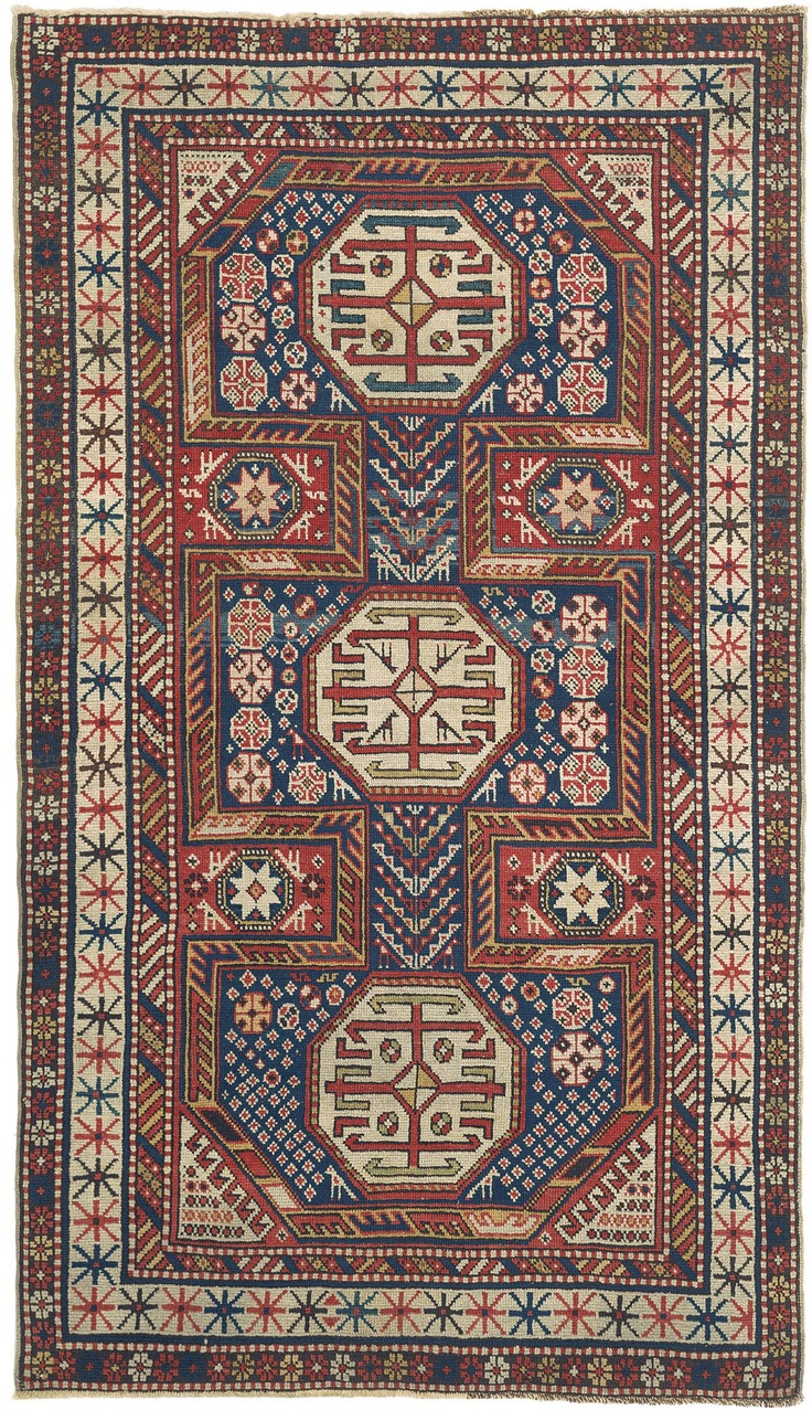 Caucasian Baku, 3ft 6in x 5ft 11in, 3rd Quarter, 19th Century. In a tremendously successful variation on the architectural design traditional to Caucasian Baku antique carpets, the field of this 150-year-old Caucasian rug is replete with multiple delightful bird, diamond, Tree of Life, and Star of Wisdom forms. Note the intriguing simplicity of the well-spaced sunburst motifs of the antique ivory main border. This strongly collectible Caucasian antique rug is also extremely well preserved.