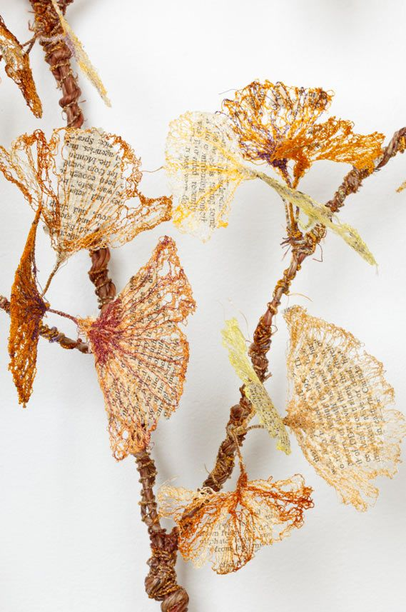 "'Amnesia' detail - art by Lisa Kokin;  this work is ""Fauxliage"" – fake leaves made from BOOK PAGES that have been SEWN to resemble Fall leaves;  the artist chose the gingko leaf for the plant's use to improve memory and Rachel Carson's book Silent Spring as a metaphor that 'historical amnesia allows the repetition of past mistakes...'"