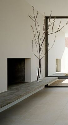I love the simple clean lines of this fireplace & hearth. This would even be nice on an enclosed porch.