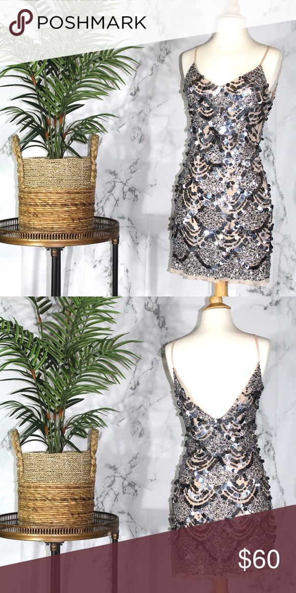 Basix Sequined Dress Length- 36 Inches Bust-24 Inches- The material does have a stretch to it**  100% silk Basix Dresses