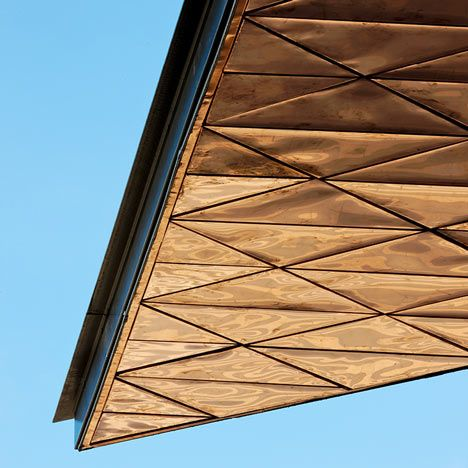 The triangular roof above the cafe-bar at Warwick University's renovated student union features a tessellated underside of polished copper.