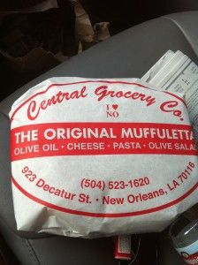 Muffuletta Sandwich - Originated in the French Quarter at the Central Grocery in New Orleans by an Italian immigrant family - Served on muffuletta loaf (Sicilian large, round, flat, sturdy bread) with olive salad, capicola, mortidella, salami, pepperoni, ham, swiss & provolone cheeses.