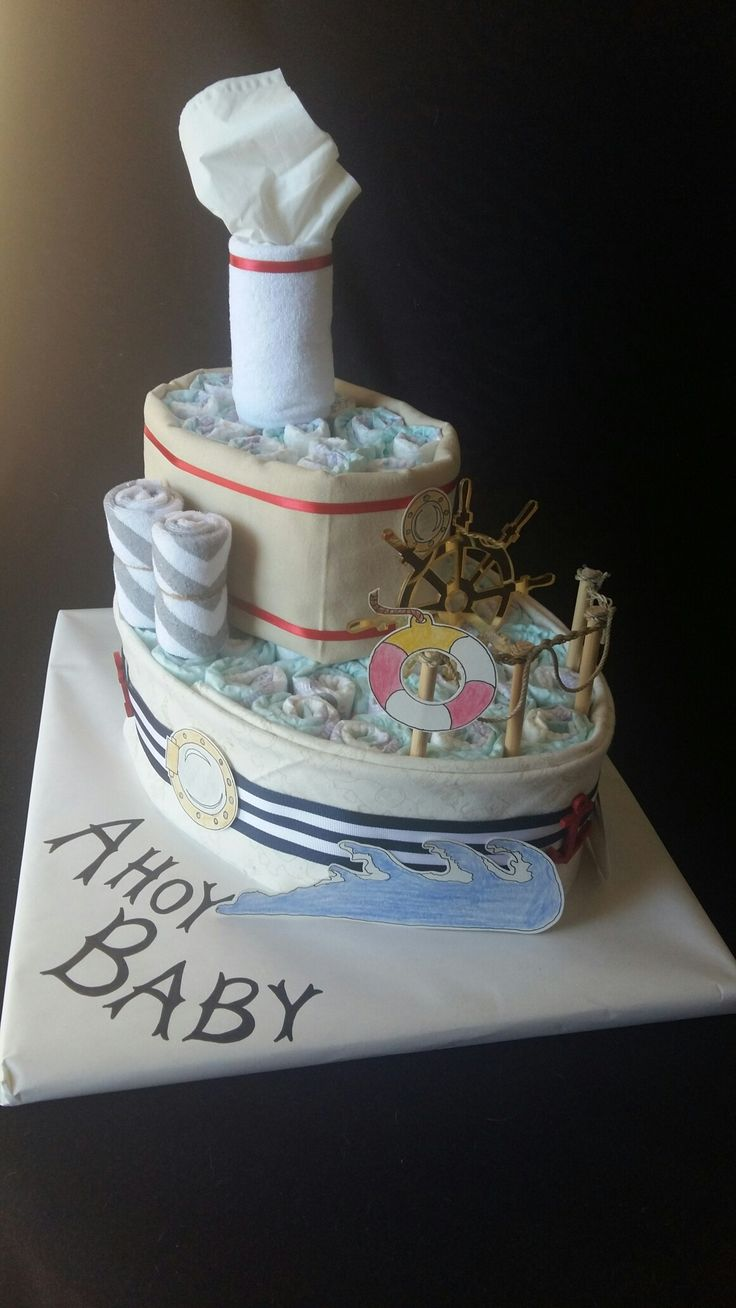 Diaper cake made with 50 diapers, 2 receiving blankets, 3 washcloths and accents.  www.TopsyTurvyDiaperCake.com - washcloth favors, washcloth animals, diaper cakes, and baby shower gifts