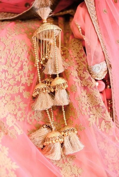 Pretty pink tassle kalire for the modern bride.