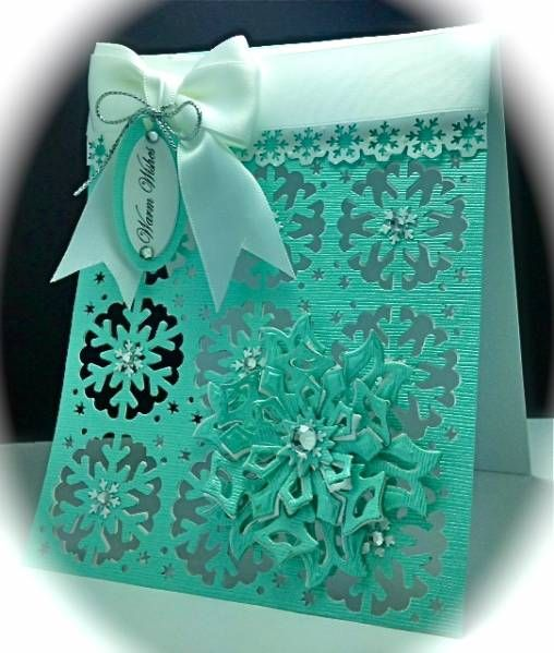The BG is punched with a MS All over the Page Punch. The Snowflakes are cut with Spellbinders dies and twice layered.