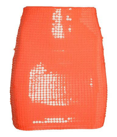 Coral. Short, fitted skirt in sequined jersey with concealed elastication at waist. Jersey lining.