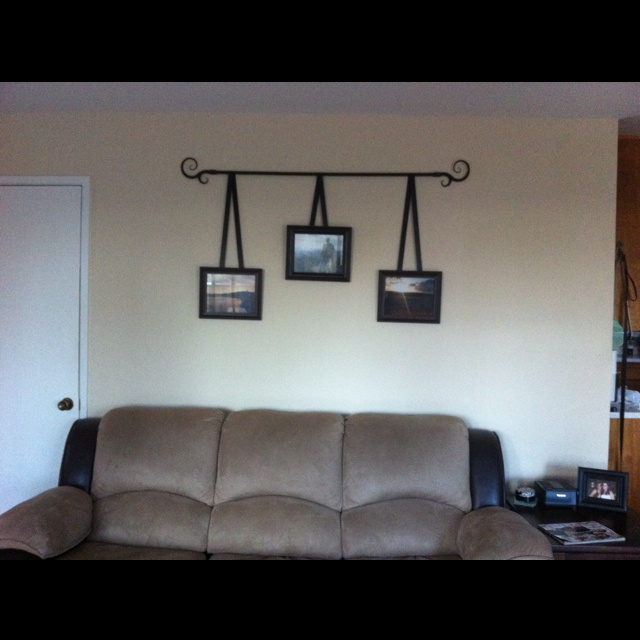 Curtain rod, three picture frames with ribbon attached by using a hot glue gun. Simple and fun project.