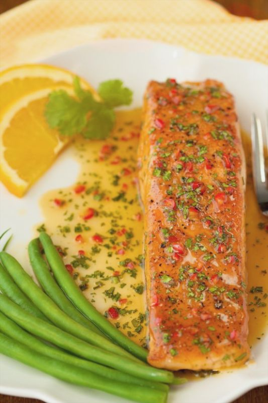 Pan-Seared Salmon with Orange-Coconut Sauce - This one is as delicious as it looks! The sweet and spicy sauce adds an amazing layer of flavor to the salmon.