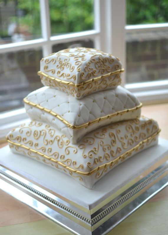 White and gold pillow wedding cake