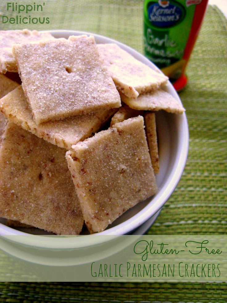 Crispy, savory, Gluten-Free Garlic Parmesan Crackers. Almond meal and flax seed add protein and healthy fats to not only make these crackers tasty, but make them good for you.