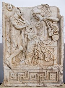 A Venus-Aphrodite velificans holding an infant, probably Aeneas, as Anchises and Luna-Selene look on (Roman-era relief from Aphrodisias)