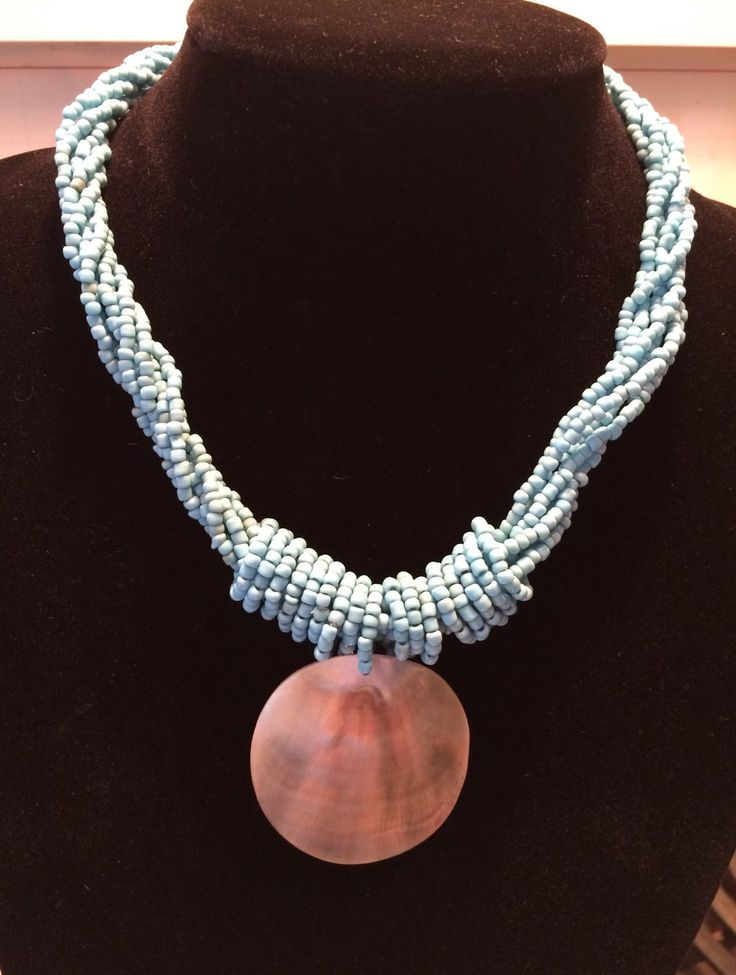 A personal favorite from my Etsy shop https://www.etsy.com/ca/listing/399627185/turquoise-necklace-shell-pendant-and
