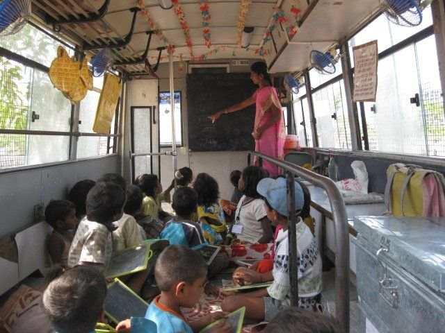 Week 8. It is essential to empower children from slums through education. It is necessary to build as many schools and sport centers in slums as possible. Public transportation is poorly developed in slums so many children don't even have chance to access school physically.  This image shows mobile bus classrooms in Mumbai which give children the chance to study.