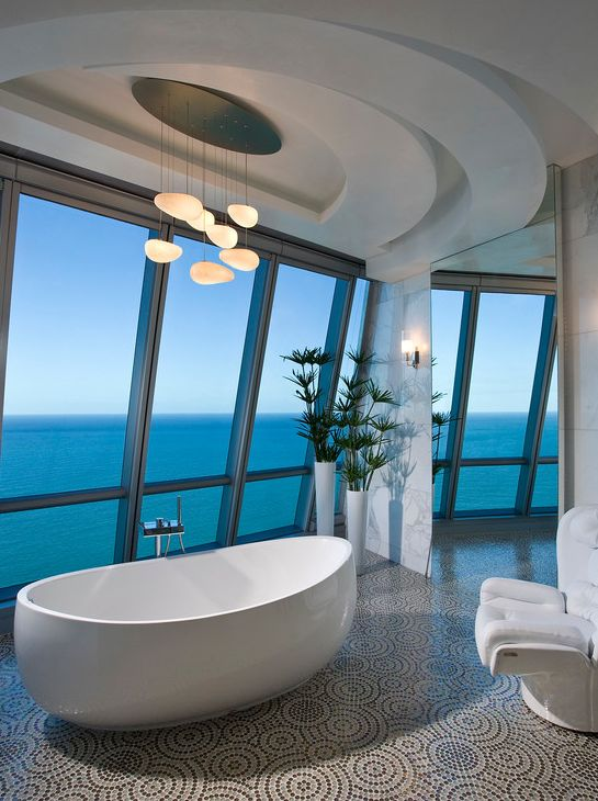 Stunning bathroom with white soaking tub, white interiors and great window's.   Penthouse Jade Ocean