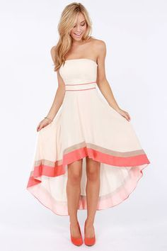 Love the cream with coral accents. Prefer a dress with straps though