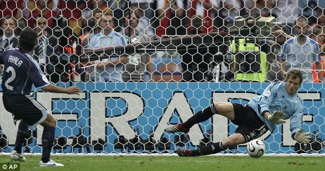 Spot of bother: Jens Lehmann saves Roberto Ayala's penalty to send Germany into the last f...