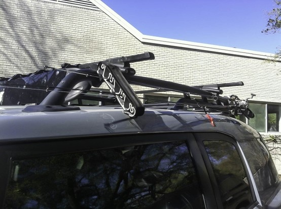 Attwood fishing rod holder modified for oem roof rack fj for Roof rack fishing rod holder