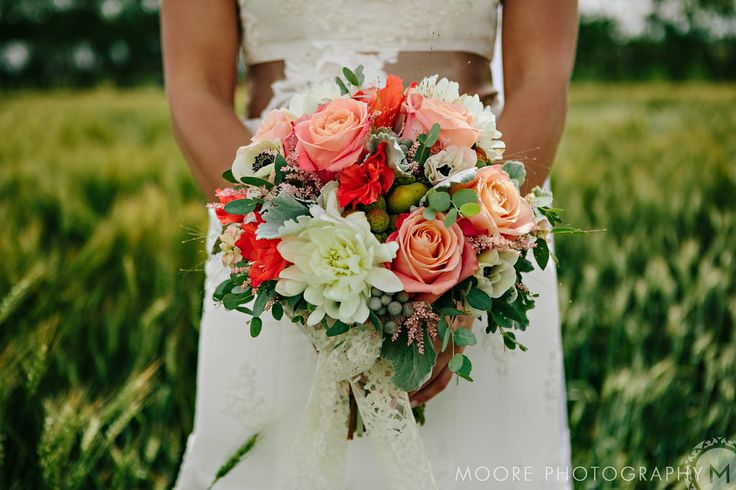 SO MUCH PERFECT. Dahlias, roses, anemones, stock, gladiola blooms, dusty miller, astilbe, brunia, and persimmons, all tied up with lace.