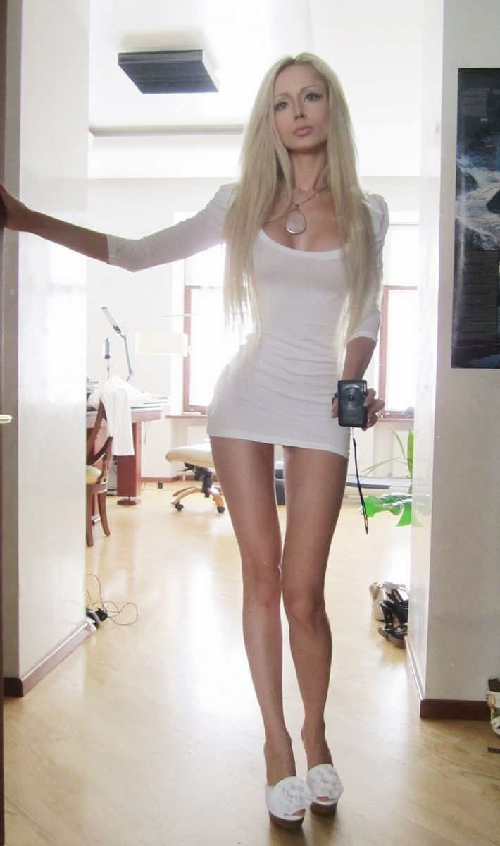 valeria lukyanova...i WISH i could look like this! lol, just gotta get fake boobies, learn how to do amazing makeup, grow my hair out a million inches (or use extensions i suppose) annnnd gain like 12inches in length in my legs lmao! but for realllll she is gorgeous!!